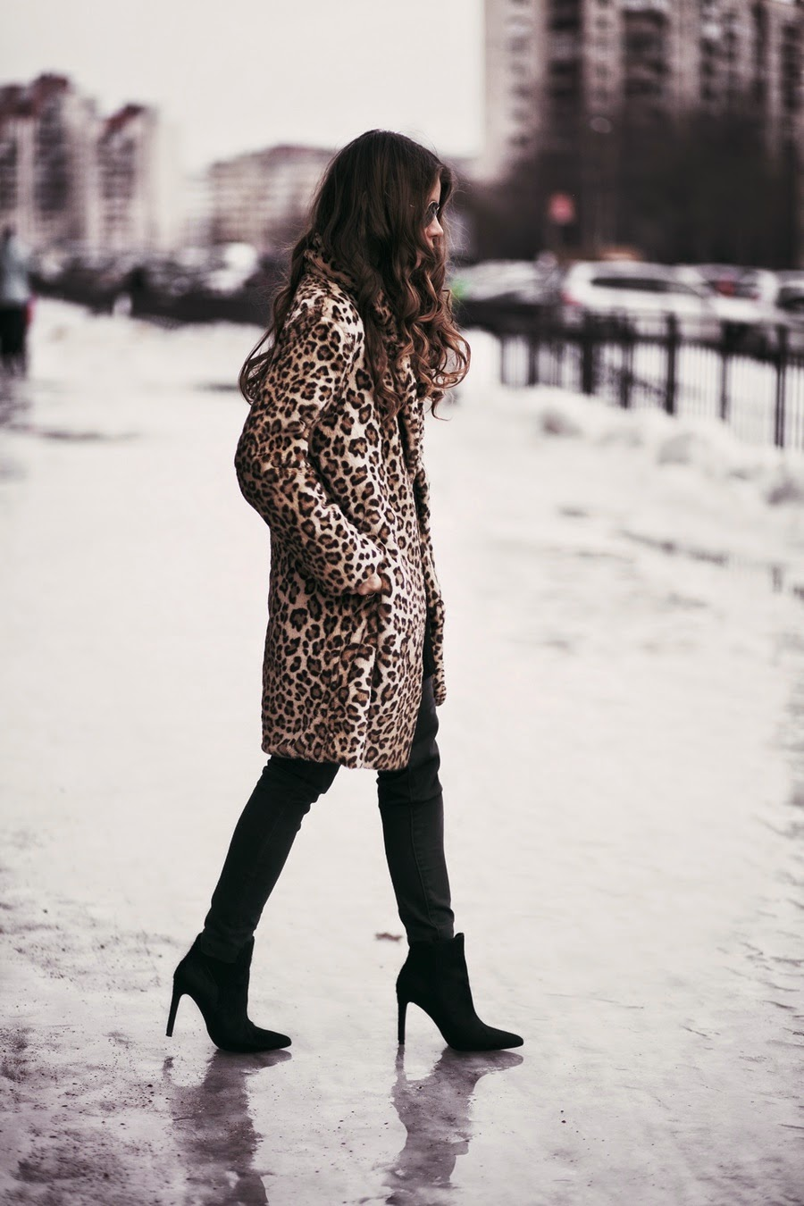 Anna Vershinina is wearing a leopard print coat from Blackfive and the ankle boots are from Zara