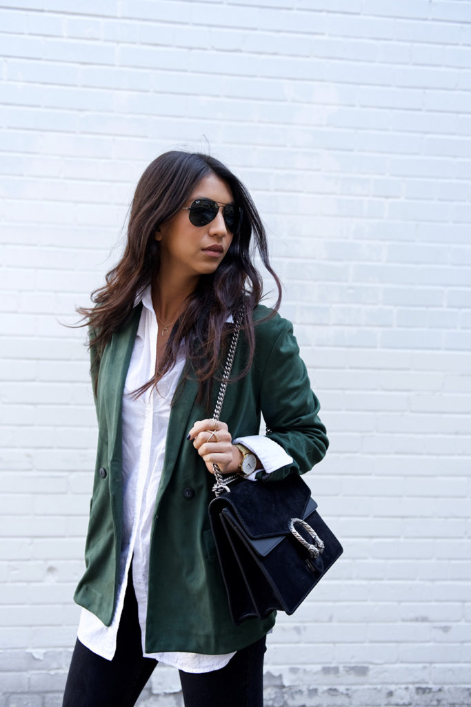 A suede jacket will look great worn with a classic white blouse and black skinny jeans. Via Kayla Seah.  Blazer: Edited, Blouse: Caslon, Jeans: Sezane, Boots: Sam Edelman, Bag: Gucci.