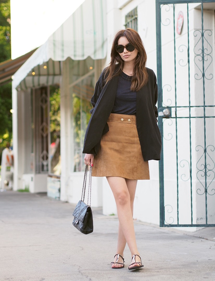 The suede skirt is turning into a Spring/Summer classic: Funda Christophersen is wearing a simple suede skirt from H&M