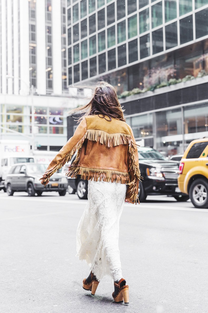Suede Fashion Trend: Sara Escudero is wearing a leather and suede fringe jacket from Ralph Lauren