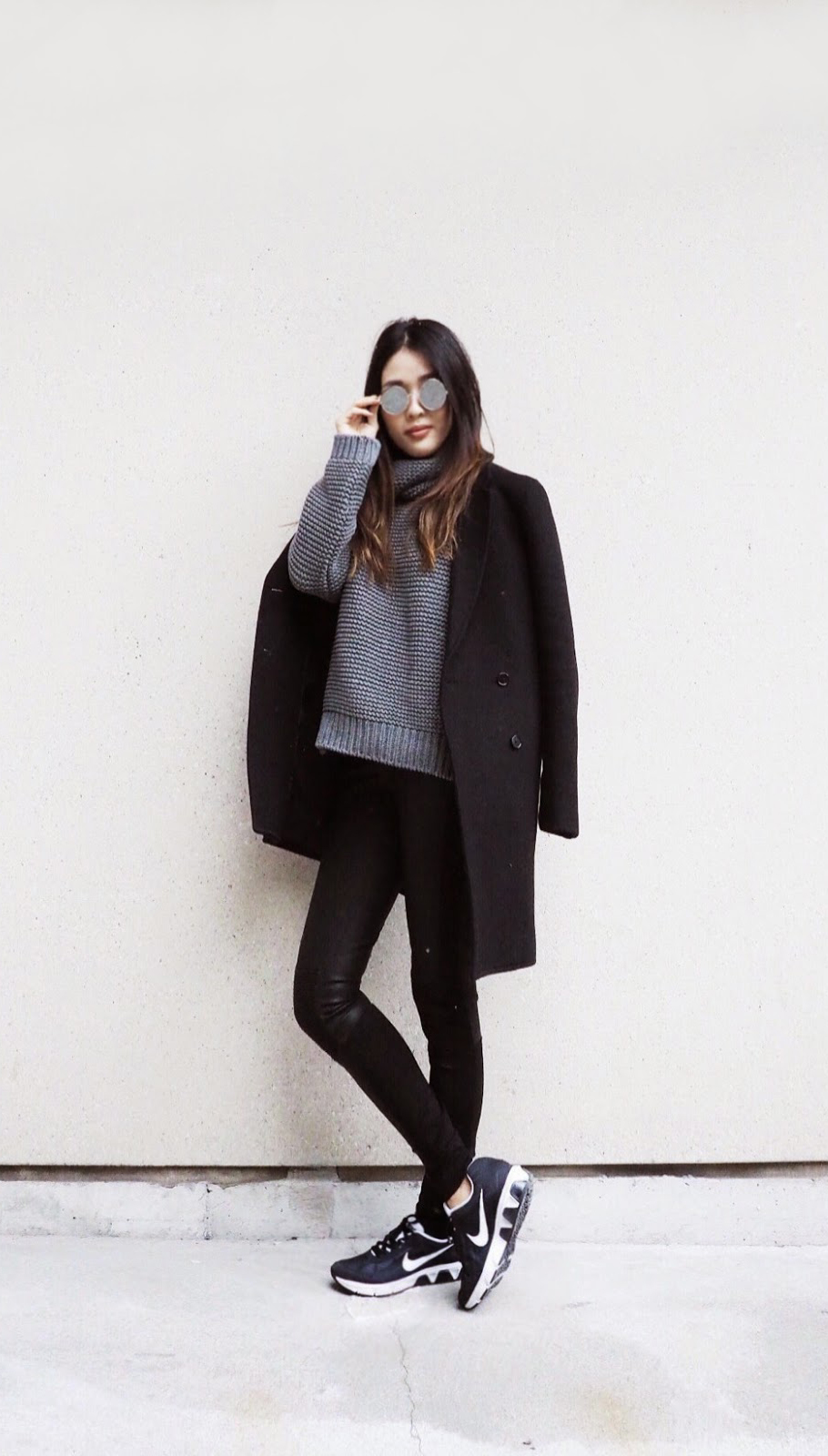 Turtleneck Trend: Cher Bai is wearing a grey heavy knit turtleneck from Zara