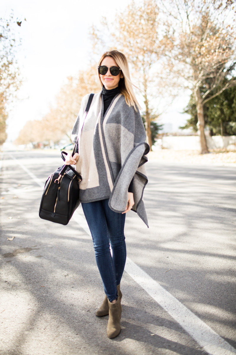 An oversized poncho is essentially a must-have this season. Emily Jackson shows us how to wear the trend, rocking a statement grey number with jeans and pale brown boots. Sweater/Bag/Boots: Sole Society, Jeans: Rag & Bone.