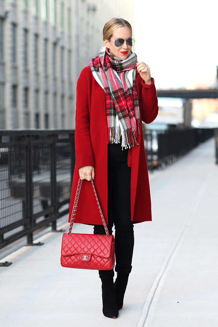 Red is our go-to colour for this festive season. Helena Glazer wears a statement red coat with a matching tartan scarf and cute hangbag, making for an overall greatly impressionable look. Coat: Vince, Jeans: Citizens of Humanity, Boots: Louboutin, Scarf: ASOS.