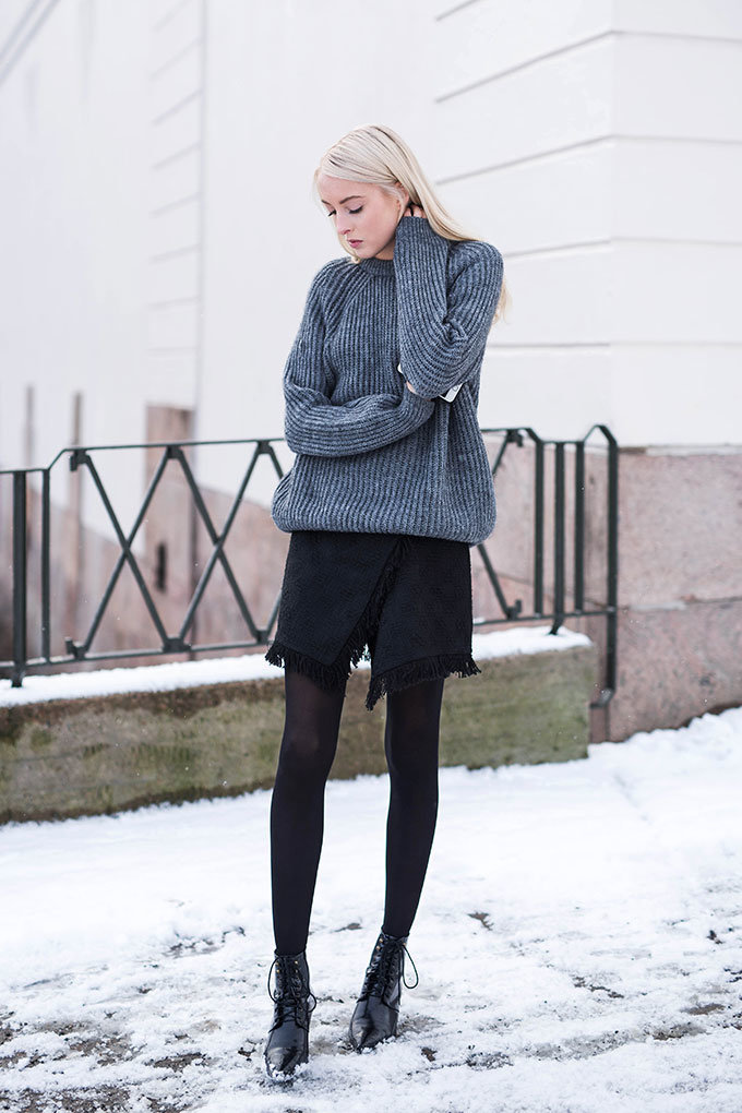Ellen Claesson is wearing a grey knit jumper and black skirt from Zara and the boots are from Mango