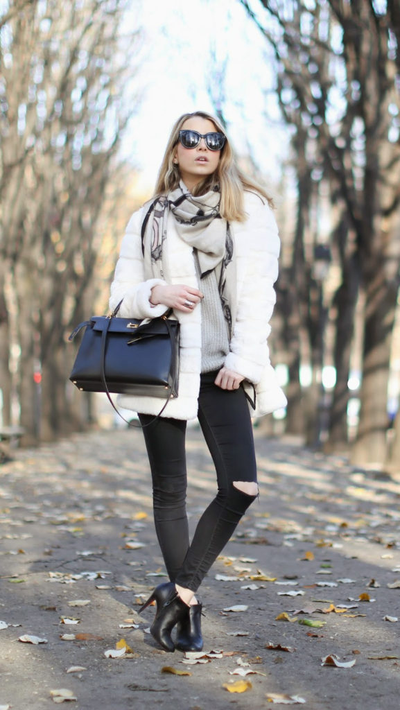 Winter Style: Caroline Louis is wearing a white coat and grey top from Zara, black jeans from TopShop, shoes from Christian Loboutin and the scarf and bas is from Hermès
