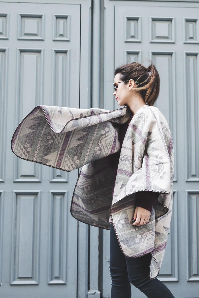 Blanket Coat Trend: Sara Escudero is wearing an aztec print Fashion Pills poncho