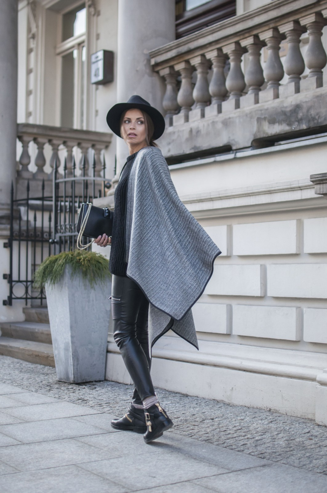 Blanket Coat Trend: Dorota Jawinska is wearing a grey LeBrand cape