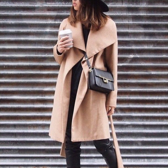 Just The Design: @hazelfire is wearing a camel coat with a black mini bag and jeans