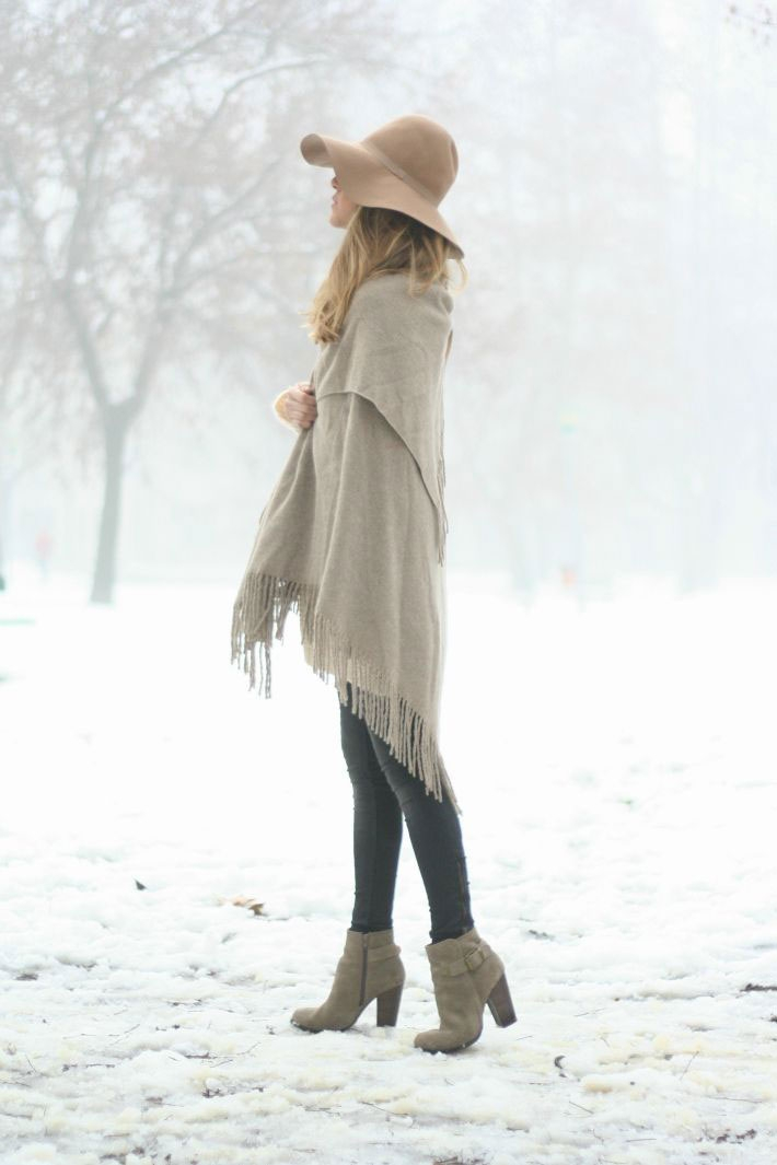 This beige blanket coat is shown off via an unknown blogger