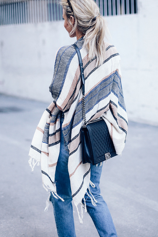 How To Wear A Blanket Coat: Mary is wearing a creme pinstripe poncho
