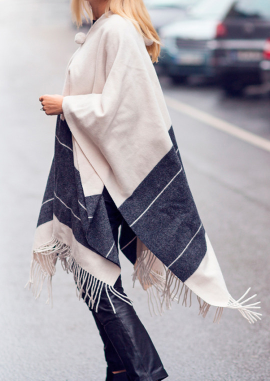 Blanket Cape Coat: Sofi Fahrman is wearing a creme and navy Malene Birger fringed poncho