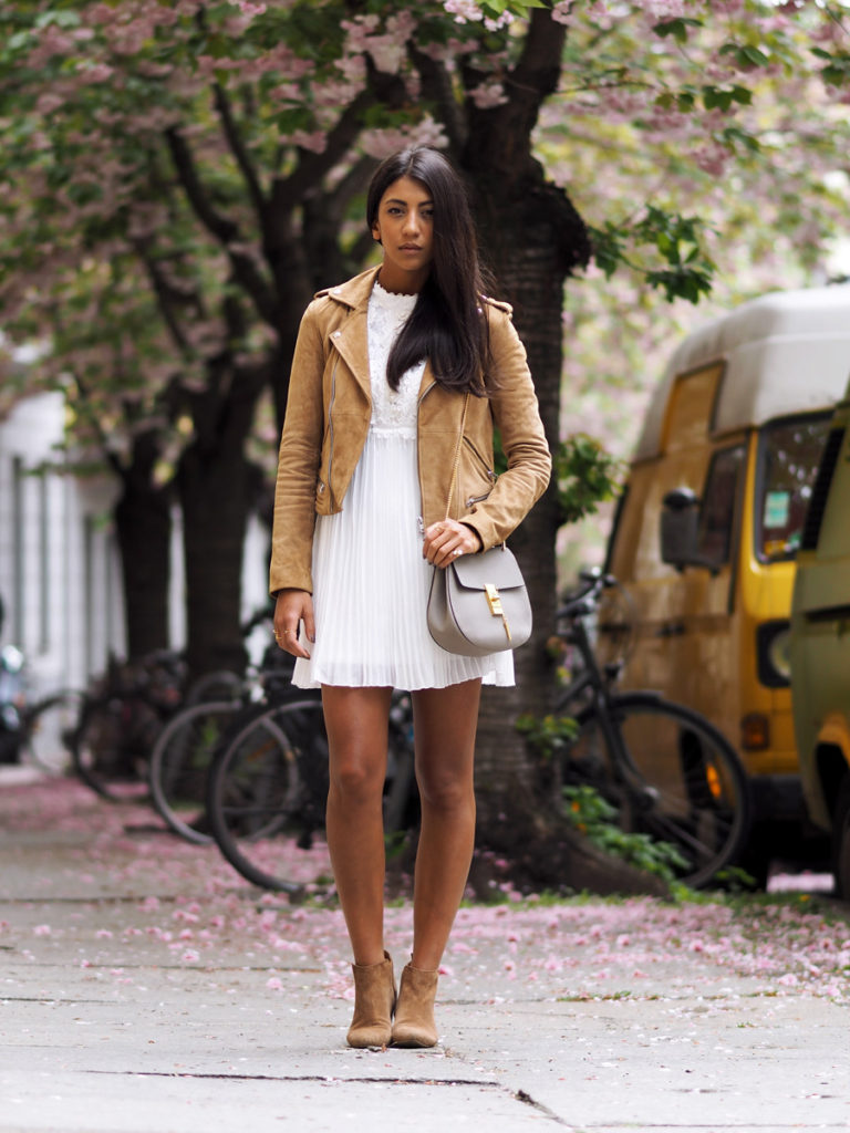 Styling A Suede Jacket: Kayla Seah is wearing a suede camel Maje biker jacket