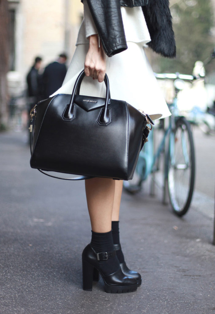 Black and White Outfit Ideas: Silvia Garcia is wearing a white Zara skirt with a black Givenchy handbag and heels