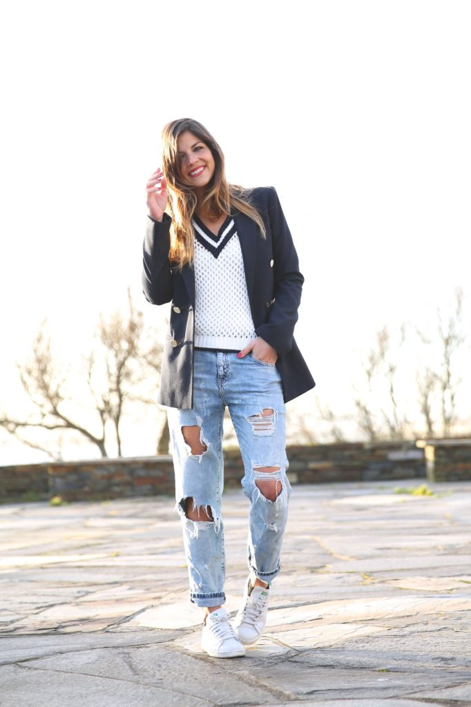 Fashion Pills sweater with a navy blazer and jeans all from Zara