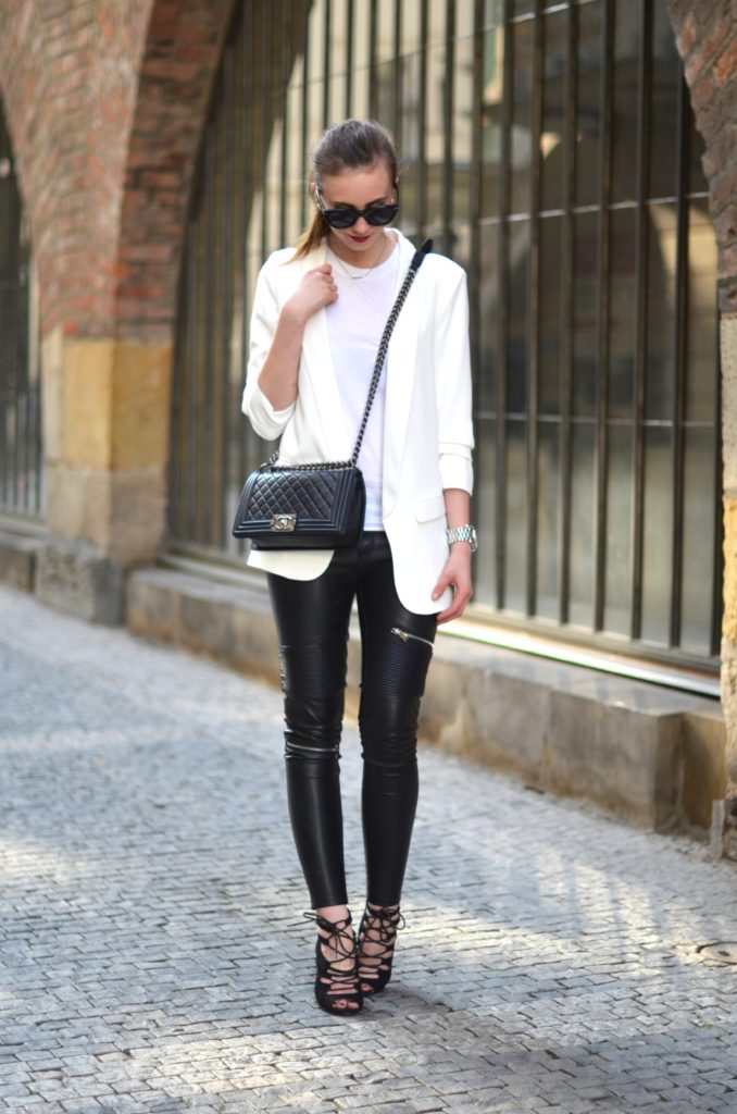 Black And White Blazer Outfit: Barbora Ondrackova is wearing a white Zara blazer over an Acne top with a pair of Zara leather leggings and black lace up Choies heels