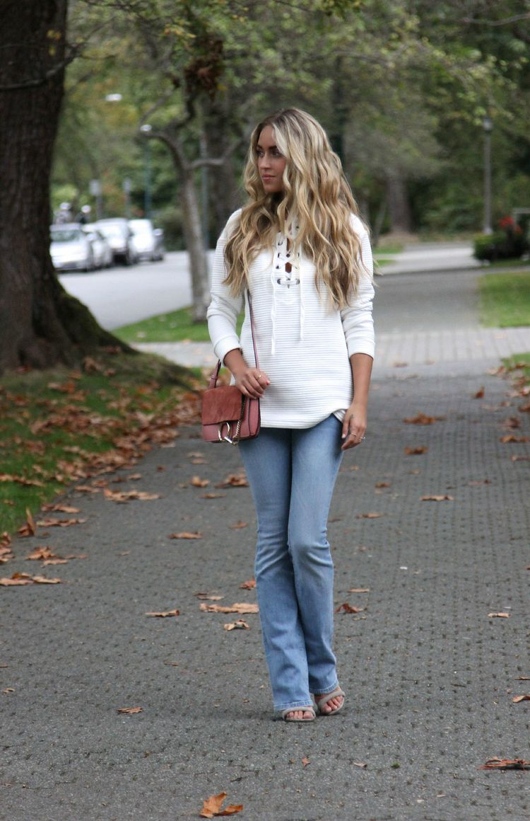 Cara McLeay is wearing wide leg jeans with a cute cross detailed top. Top/Jeans: Forever 21.