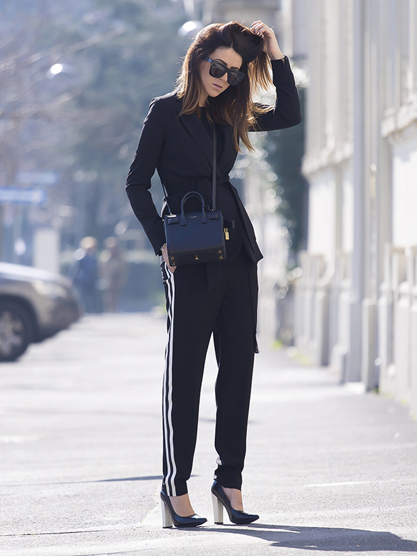 Athleisure Style: Nicoletta Reggio is wearing white striped black trousers from Beatrice B., shoes from Sarenza, bag from Saint Lauren and the sunglasses are from Valley Eyewear