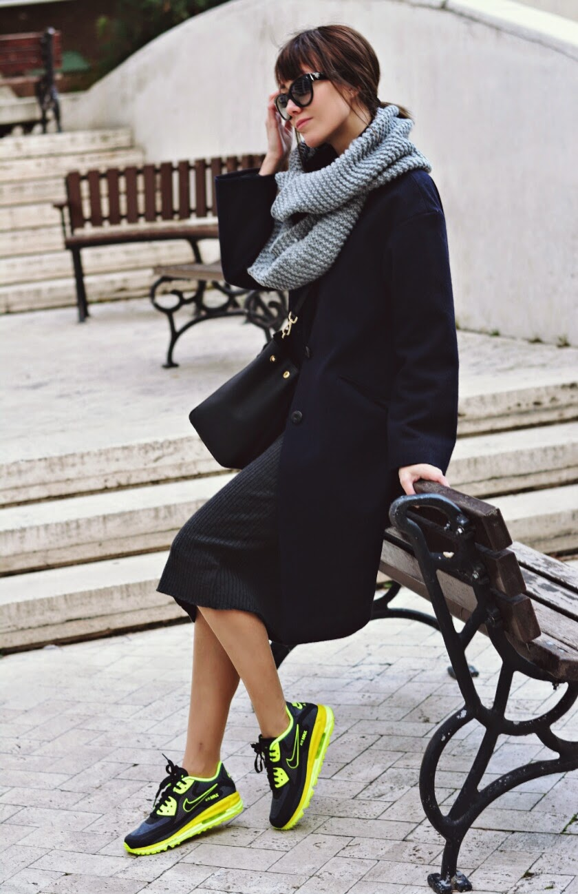 Athleisure Still Rules: Paris Sue is wearing a black coat and grey dress from Aici - Buradan, black scarf from H&M, sunglasses from Prada, bag from Michael Kors and the sneakers are from Nike