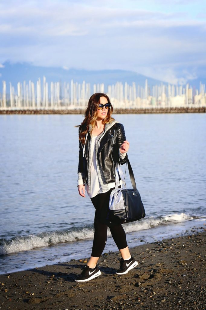 Atleisure Trend: Alexandra Grant is wearing black tights from Victoria's Secret, bag from Lululemon, grey top and hoodie from Gentle Fawn and the leather jacket is from Joe Fresh