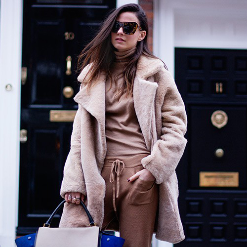 Athleisure Fashion Trend: Zina Charkoplia is wearing all camel, vintage teddy coat, sweatpants and top from Zara