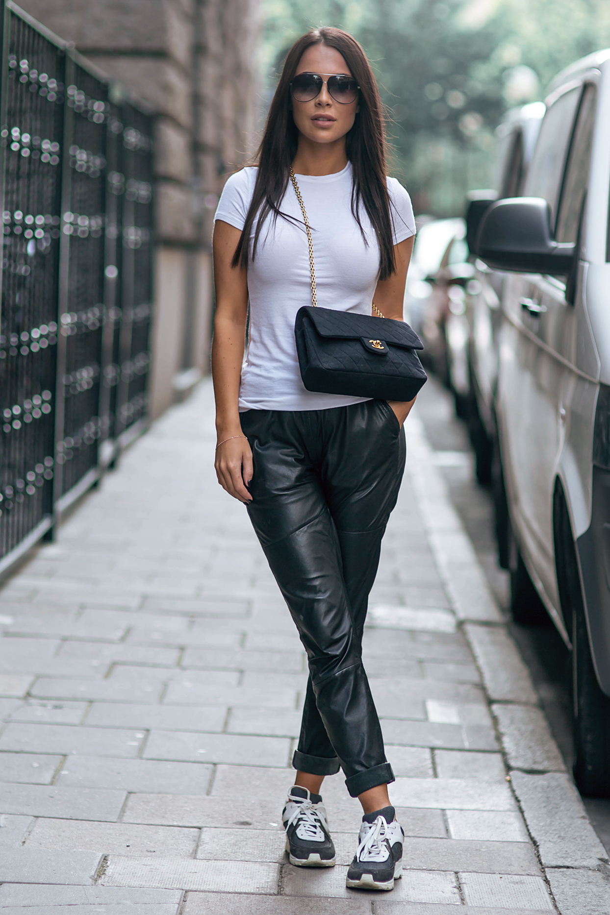 Wear the black and white trend like Johanna Olsson, and pair a simple white tee with leather trousers and monochrome sneakers. This casual style is perfect for any outing! Trousers: Designers Remix, Tee: ATM, Sneakers/Bag: Chanel.