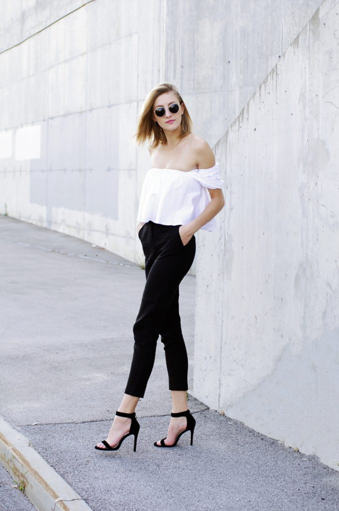 Katarina Vidic is utterly iconic in this starkly contrasting monochrome outfit consisting of gorgeous high-waisted trousers, an off the shoulder blouse, and striking black stilettos. Channelling a look such as this will always make you a winner!  Trousers: ASOS, Shirt: Zaful, Heels: Rosegal.