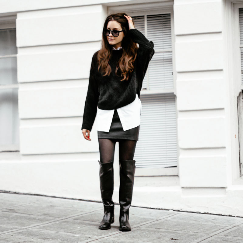Black White Outfit: Sarah Butler is wearing black over the knee boots from Seychelles, leather mini skirt from Sam Edelman, knit black jumper from Vince, and the white shirt is from Alexander Wang