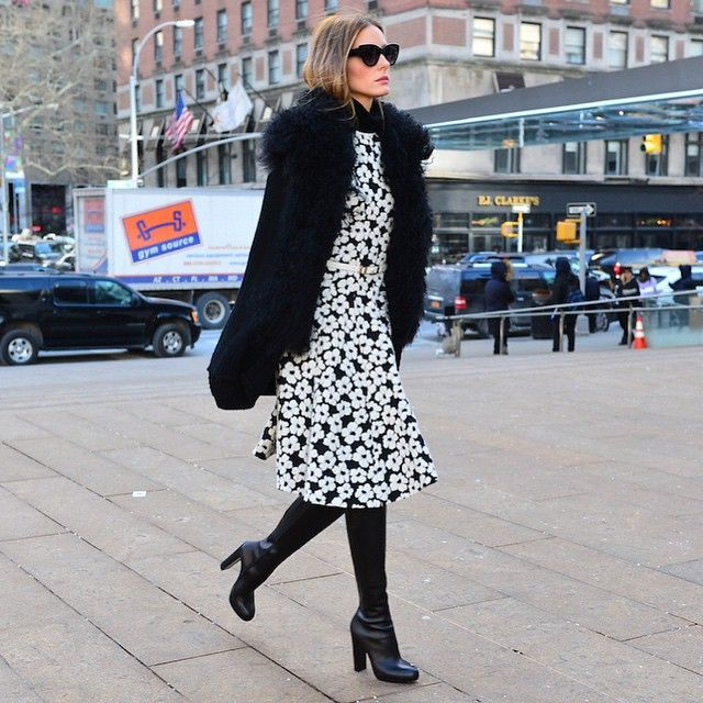 Black And White Outfits: Olivia Palermo is wearing a black shearling sweater from Vince, black and white floral dress from Carolina Herrera, black turtleneck from Tibi and the boots are from Christian Louboutin