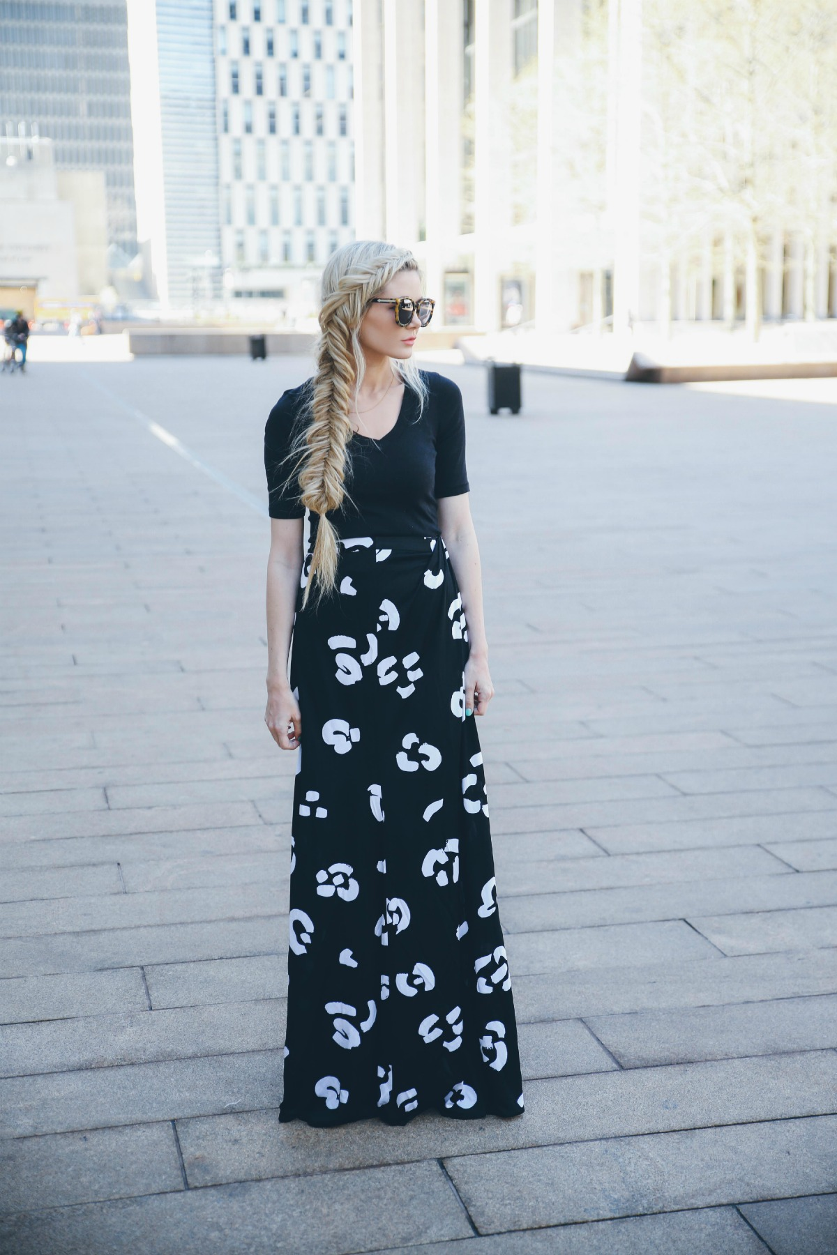 Amber Fillerup Clark is wearing a black top from Splendid, black and white skirt from Issa and the sunglasses are from from Karen Walker