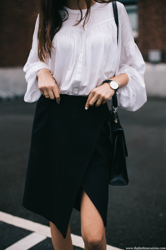 Beatrice Gutu is showing off two trends with this black and white outfit: Bell sleeves and the slit trend