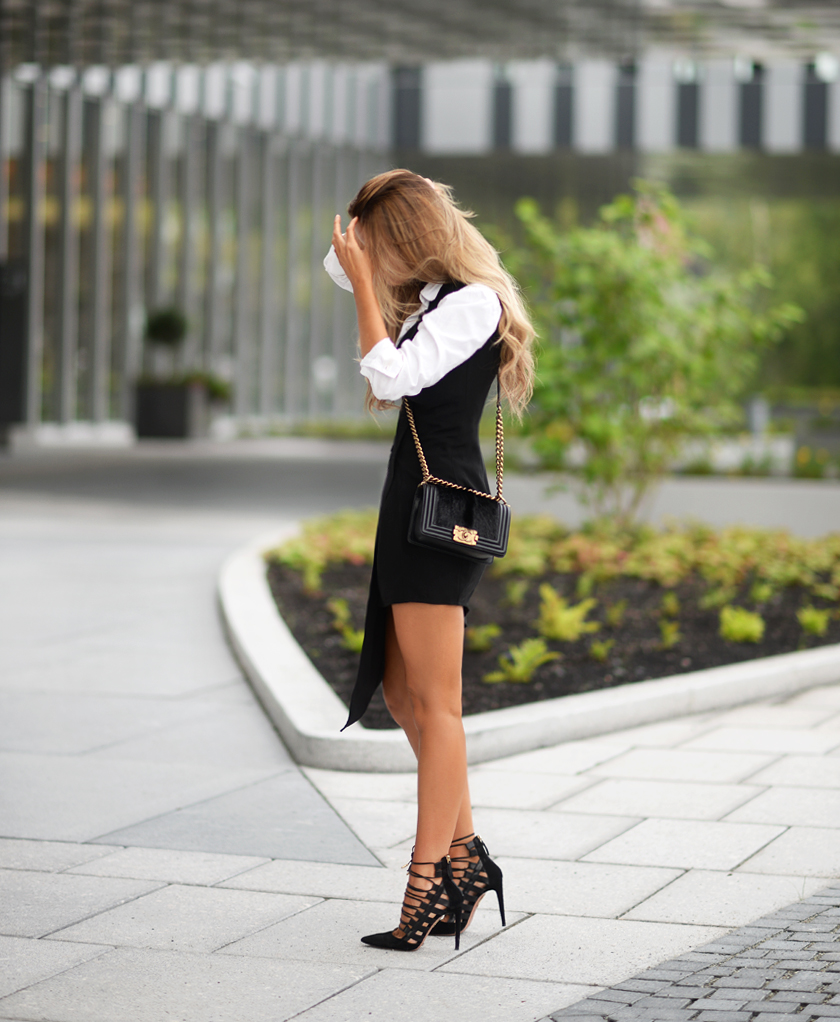 One idea that always works is a white shirt under a black sleeveless dress. Via Annette Haga Dress: NLY, Shirt: Gina Tricot, Bag: Chanel, Shoes: Aquazzura. Black And White Outfit Ideas