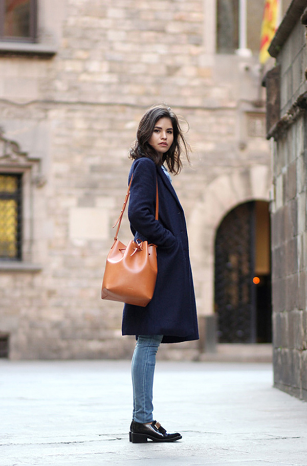 Bucket Bag Fashion Trend: Adriana Gastélum is wearing a camello and rosa coated large bucket bag from Mansur Gavriel