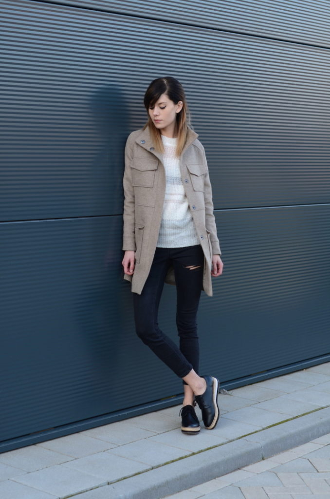 Military Fashion Trend: Lovely by Lucy is wearing a beige Asos jacket with a pair of ripped skinny jeans
