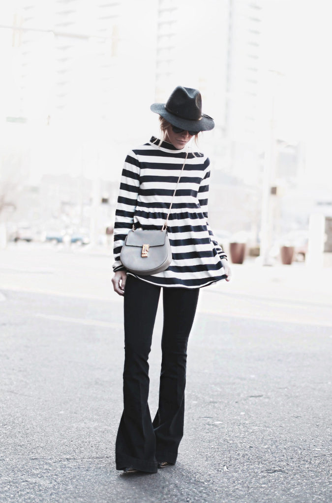 70's Trend: Mary Seng is wearing a striped top from Free People, flare jeans from Stella McCartney, bag from Chloe and the hat is from Madewell