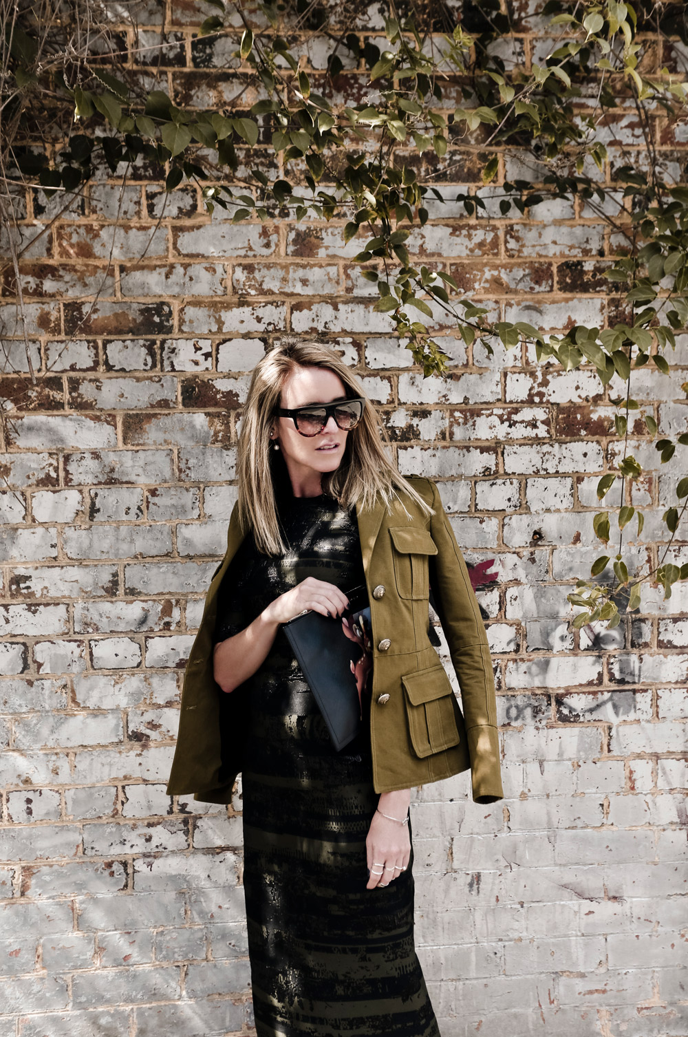 Military Fashion Trend: Mandy Shadforth is wearing a khaki Balmain jacket with a Josh Goot dress
