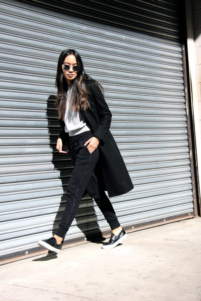 Linh Niller Huynh is showing off the athleisure trend perfectly with black Rag & Bone jogging bottoms, a grey Cos sweater and pumps from Zara