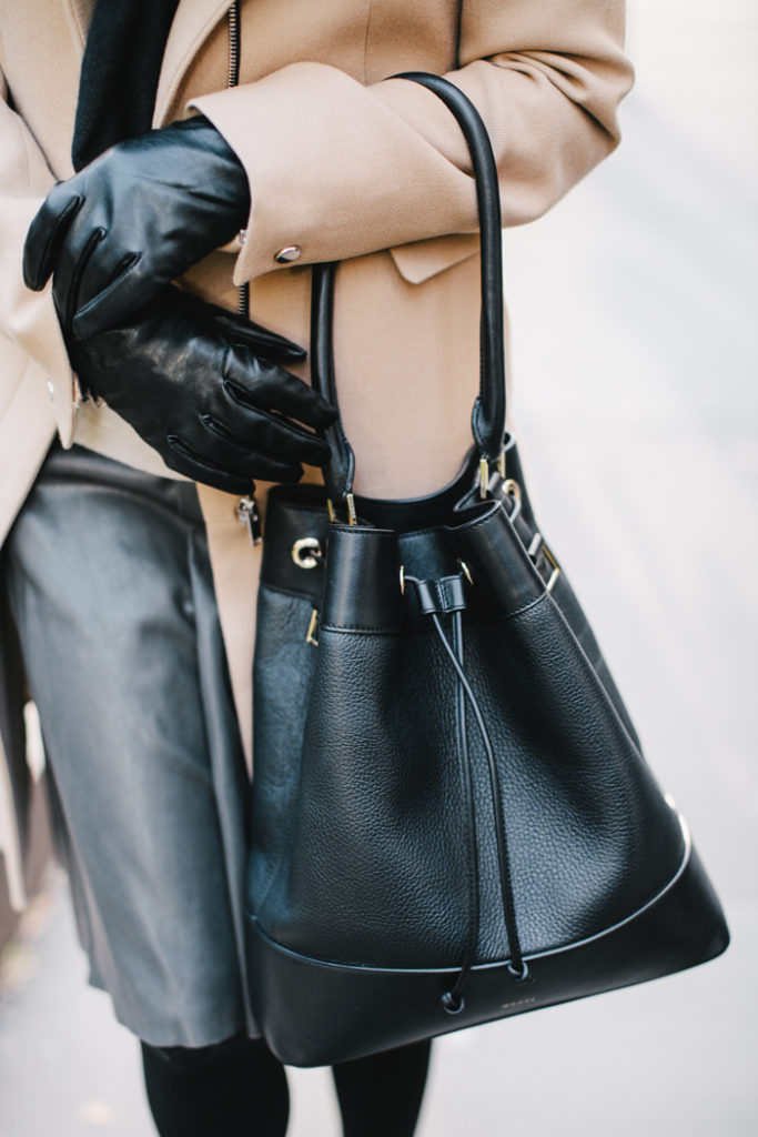Jacey Duprie is wearing a leather black Mezzi bucket bag