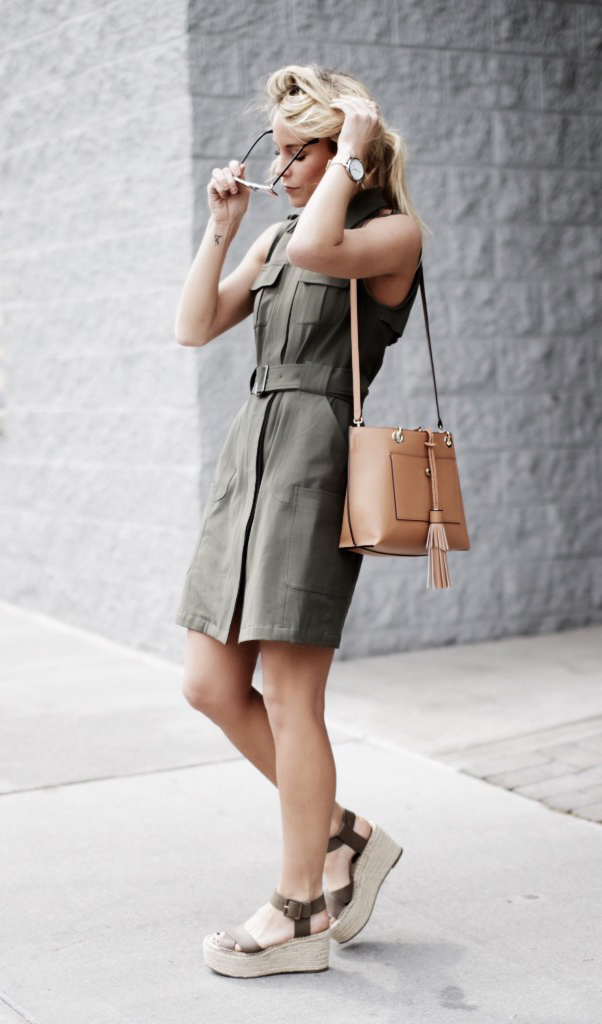 There is nothing which screams military style more than a khaki shirt dress! This belted button up shirt dress just oozes edge and sophistication, and we love Mary Seng's choice to wear the look with a pair of espadrilles for added summer style. Dress: Nordstrom, Shoes: Marc Fisher, Bag: Henri Bendel.