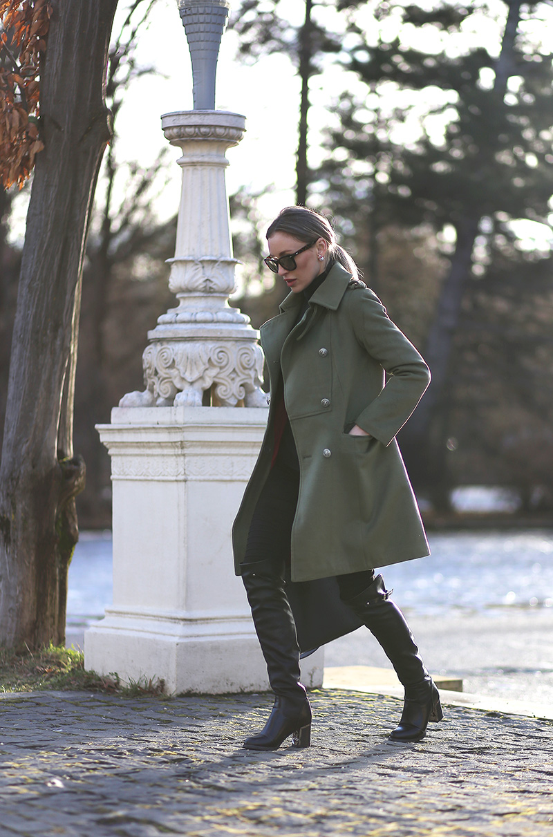 Steal Ioana Chisiu's hot military style by wearing a classic khaki army jacket with leather over the knee boots and a pair of Ray Bans! This look is seasonal, stylish, and individual; we love it! Coat: Sheinside, Jeans: Glittio, Boots: Michael Kors.