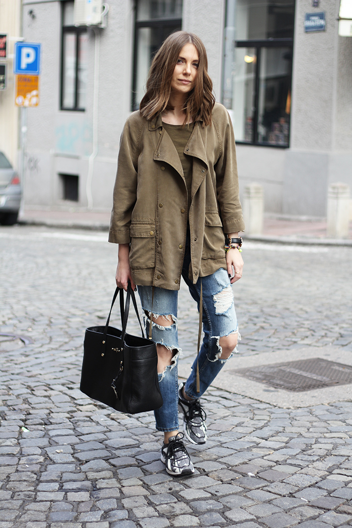 Vanja Milicevic is wearing an army green T-shirt and jacket both from Zara