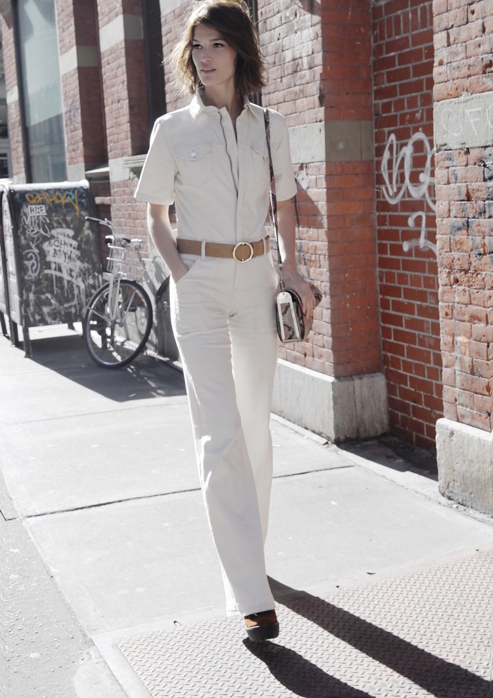 That 70's Style: Hanneli Mustaparta is wearing white top and bottom from Frame Denim, the bag is from Salavtore Ferragamo and the boots from Polo Ralph Lauren