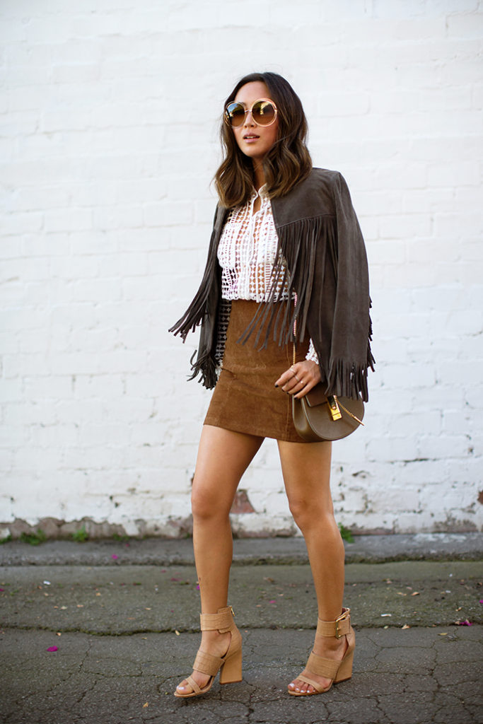 70′s Boho Chic: Aimee Song is wearing round sunglasses and bag from Chloe, suede fringe jacket from The Pefext, white lace blouse from Self Portrait, vintage suede skirt and the shoes are from Sigerson Morris