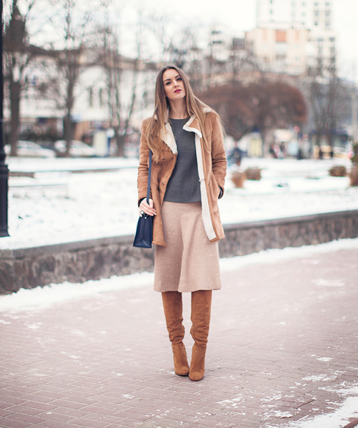 70's Inspired: Style: Nika Huk is wearing a shearling coat from Forever 21, grey top and beige knitted skirt from Sheinside and the bag and boots are from Zara