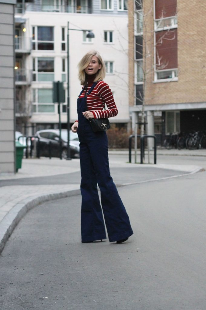 Tine Andrea is wearing dark blue denim overalls and red and white striped turtleneck from Zara, sunglasses from Cheap Monday and the bag is from Givenchy