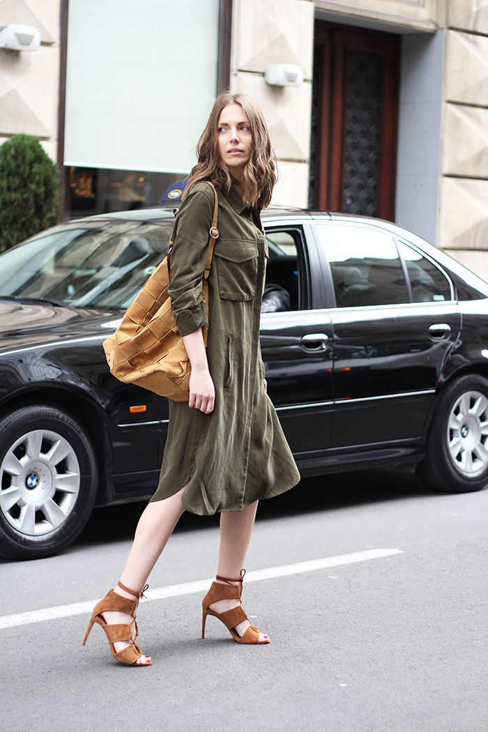 Vanja Milicevic is rocking a casual military style here consisting of a simplistic khaki shirt dress and a pair of tan suede heels. This look is affordable and achievable; perfect for everyday wear! Outfit: Zara.