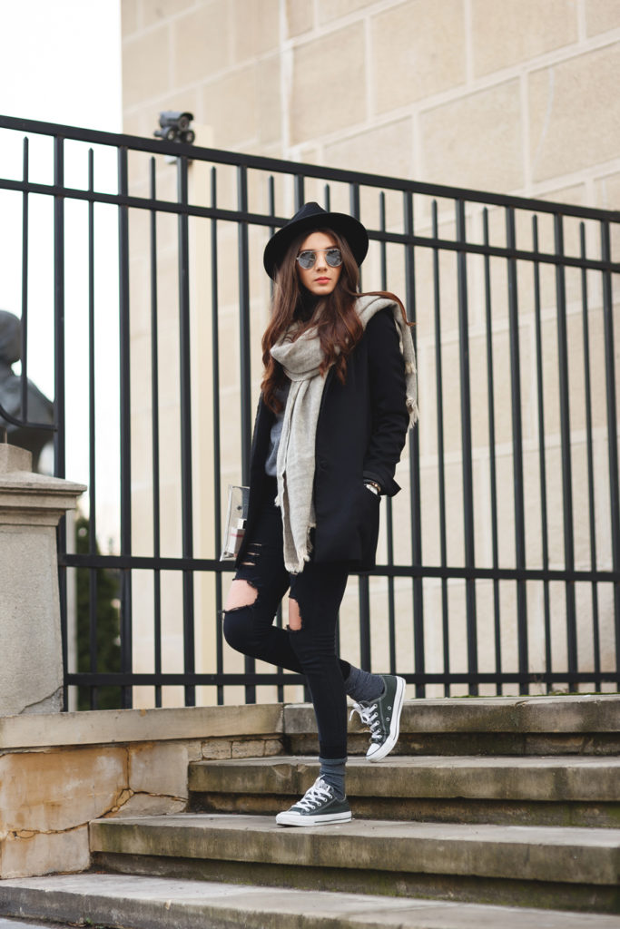 Black Ripped Jeans: Larisa Costea is wearing black jeans and a grey scarf from Sheinside, turtleneck from Kurtmann, black blazer from Zara, sneakers from Converse and the hat is from Oasap
