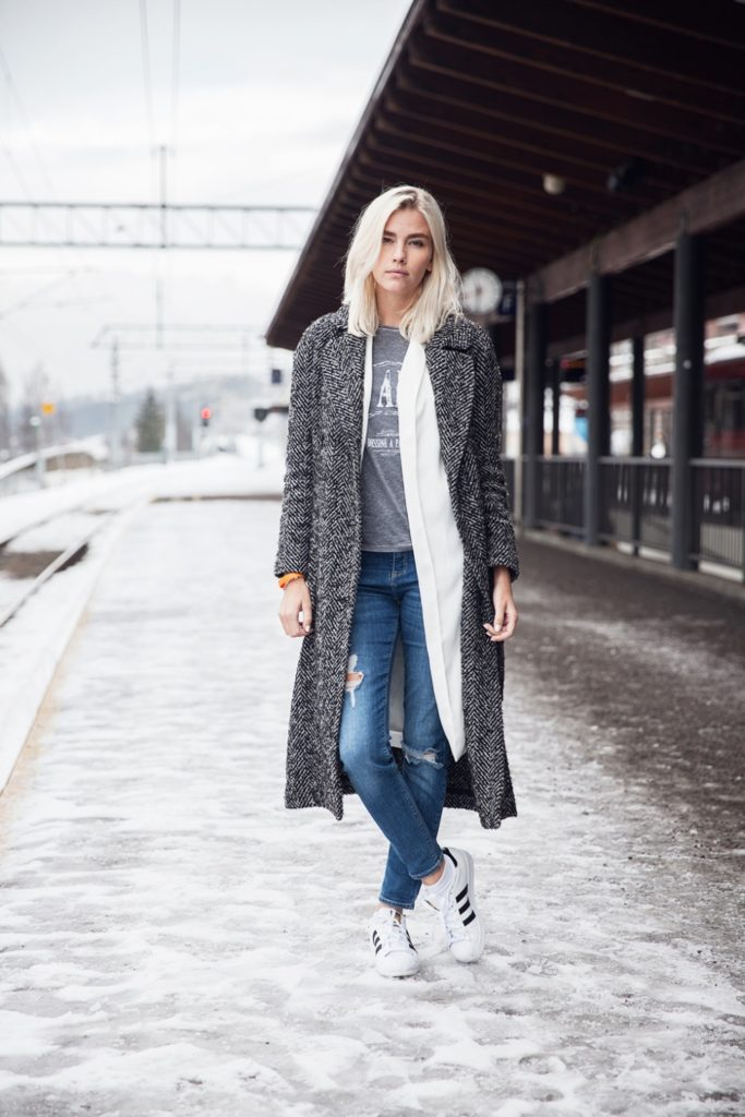 Elsa Ekman is wearing a coat and jeans from River Island, T-shirt from Zadig & Voltaire and the shoes are from Adidas