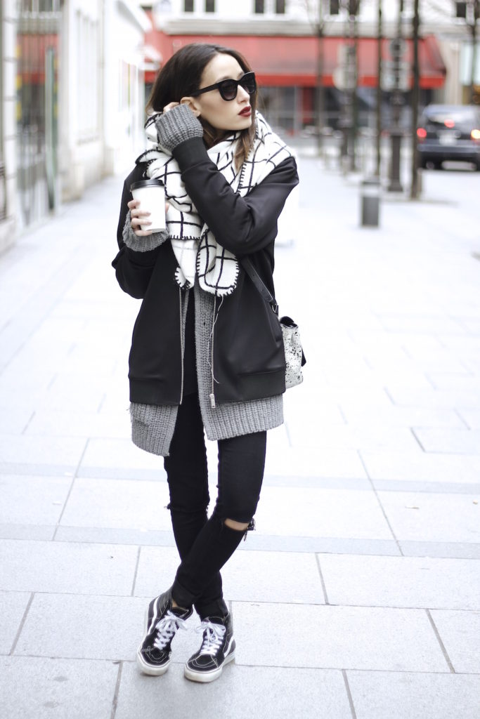 Alexandra Guerain is wearing a mens jacket from COS, grey cardigan from Zara, scarf and jeans from Asos and the shoes are from Vans