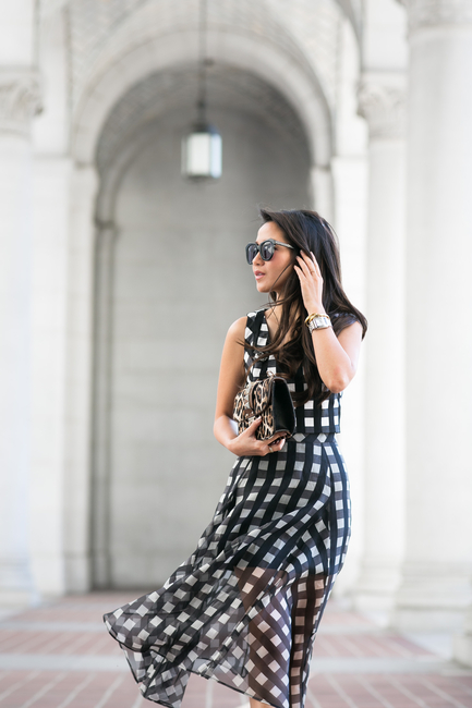 Wendy Nguyen is wearing a black and white check top and skirt from Marissa Webb