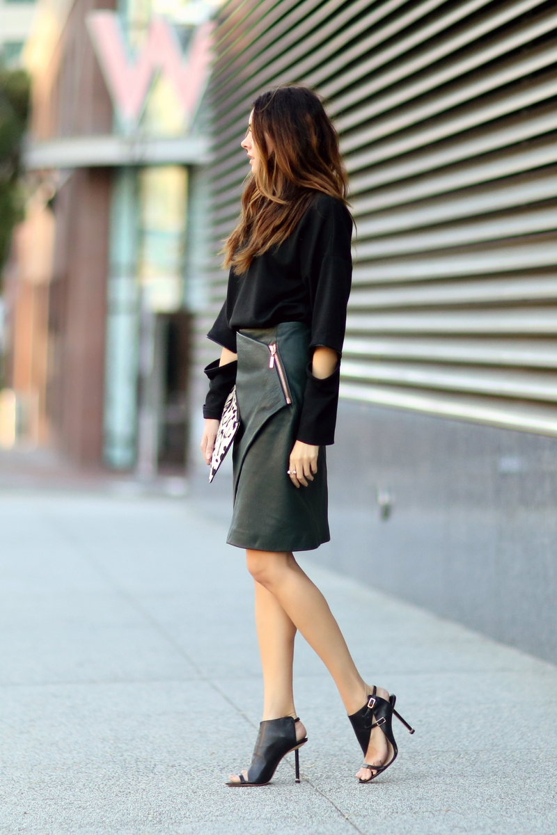 Black Leather Skirt Looks: Erica Hoida is wearing all black, the top is from Madison Peyton New York leather skirt from Cedric Charlier, shoes from Camilla Skovgaard and the clutch is from Jerome Dreyfuss